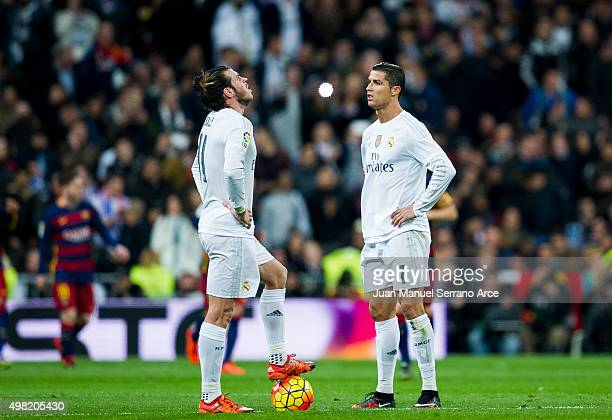 Cristiano Ronaldo and Gareth Bale of Real Madrid reacts during the La Liga match between Real Madrid CF and FC Barcelona at Estadio Santiago...