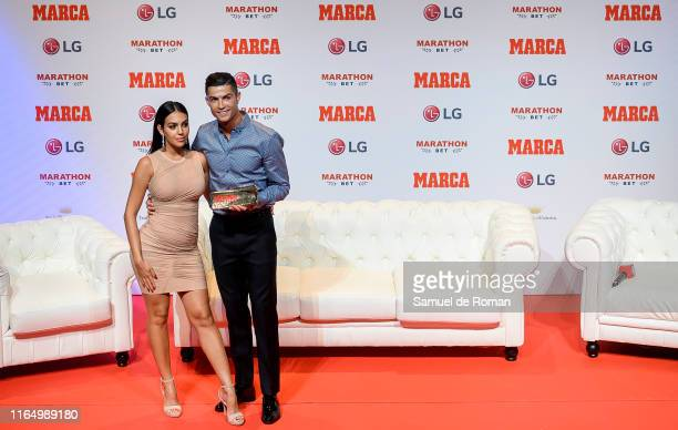 Cristiano Ronaldo and Georgina Rodriguez posing to media with 'Marca Leyenda' award on July 29 2019 in Madrid Spain