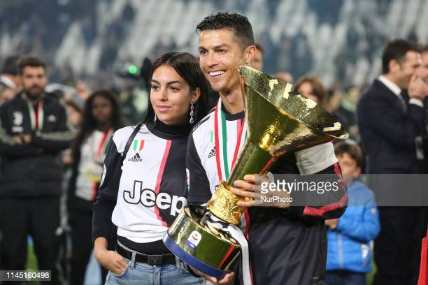 Cristiano Ronaldo and Georgina Rodriguez with the trophy of Scudetto during the victory ceremony following the Italian Serie A last football match of...