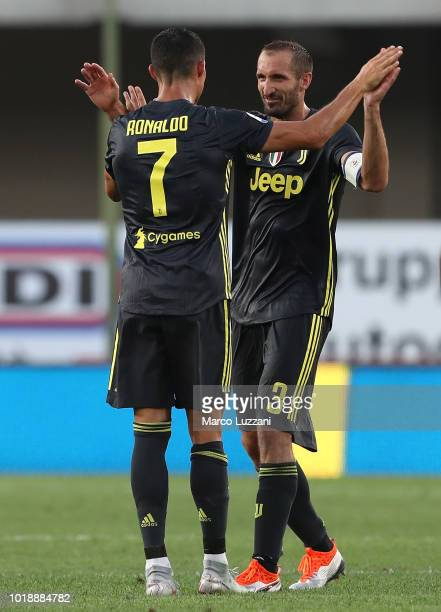 Cristiano Ronaldo and Giorgio Chiellini of Juventus celebrate a victory at the end of the the serie A match between Chievo Verona and Juventus at...