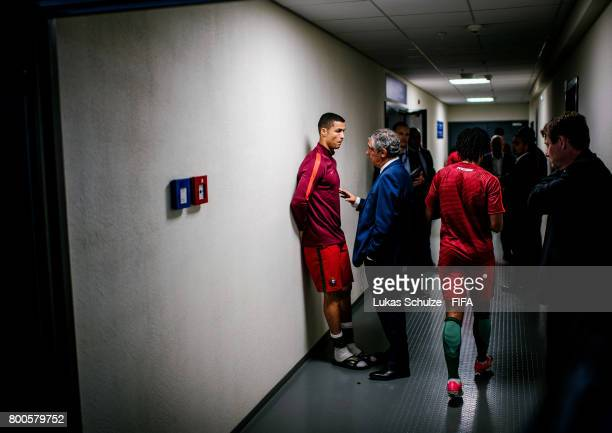 Cristiano Ronaldo and his Head Coach Fernando Santos talk to each other in the player tunnel after winning the FIFA Confederations Cup Group A match...
