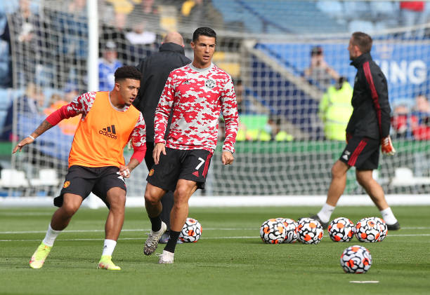 Cristiano Ronaldo and Jadon Sancho of Manchester United warms up ahead of the Premier League match between Leicester City and Manchester United at...