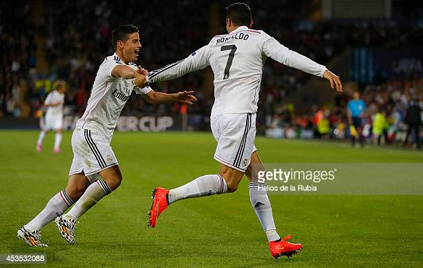 Cristiano Ronaldo and James Rodriguez of Real Madrid celebrate after scoring during the UEFA Super Cup match between Real Madrid and Sevilla at...