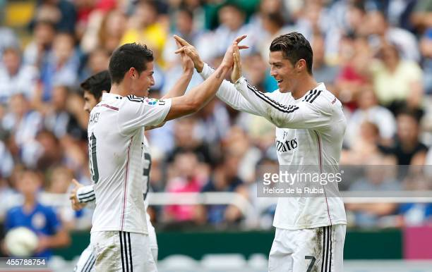 Cristiano Ronaldo and James Rodriguez of Real Madrid celebrate after scoring during the La Liga match between RC Deportivo La Coruna and Real Madrid...