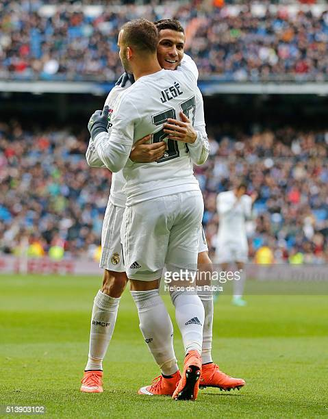 Cristiano Ronaldo and Jese Rodriguez of Real Madrid celebrate after scoring during the La Liga match between Real Madrid CF and Celta Vigo at Estadio...