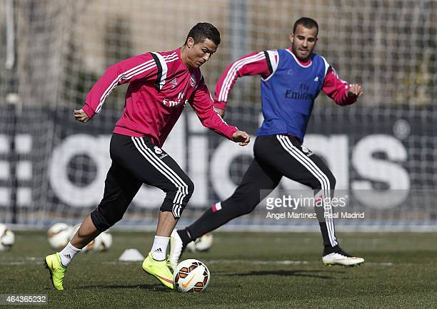 Cristiano Ronaldo and Jese Rodriguez of Real Madrid in action during a training session at Valdebebas training ground on February 25 2015 in Madrid...