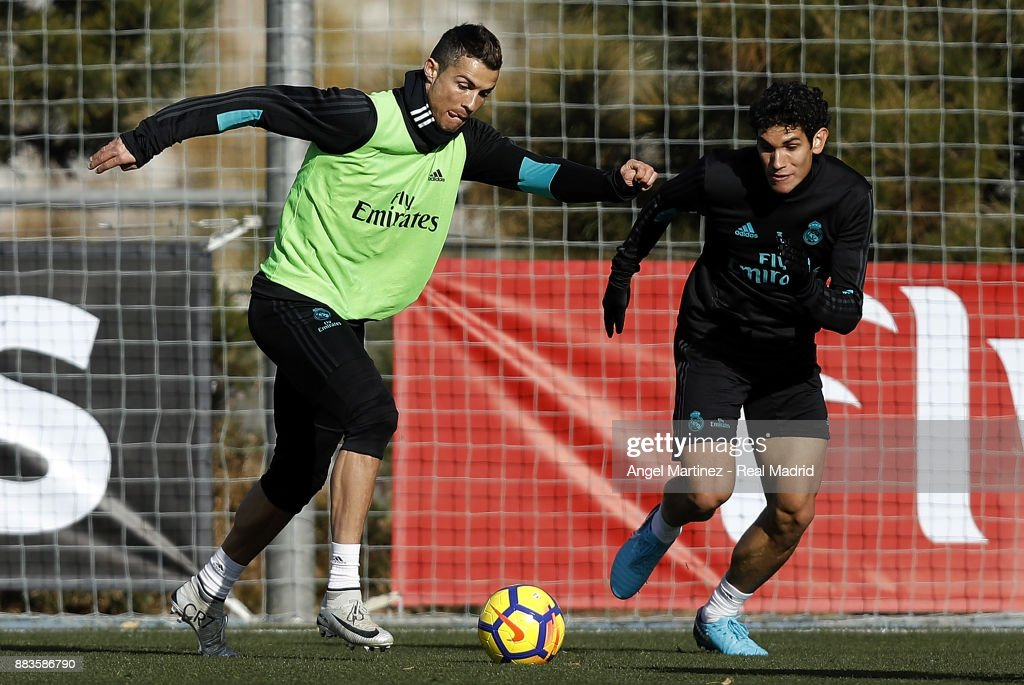 Cristiano Ronaldo (L) and Jesus Vallejo of Real Madrid in action during a training session at Valdebebas training ground on December 1, 2017 in Madrid, Spain.