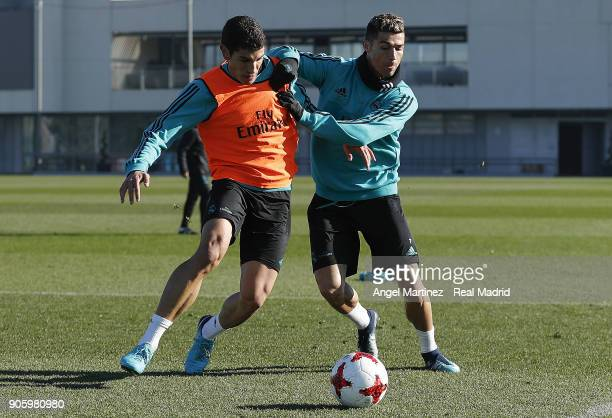 Cristiano Ronaldo and Jesus Vallejo of Real Madrid in action during a training session at Valdebebas training ground on January 17 2018 in Madrid...