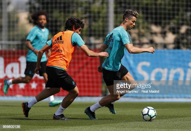 Cristiano Ronaldo and Jesus Vallejo of Real Madrid in action during a training session at Valdebebas training ground on May 18 2018 in Madrid Spain