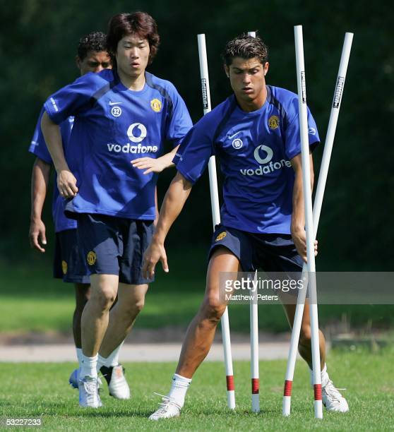 Cristiano Ronaldo and Ji Sung Park of Manchester United in action during a first team Pre Season training session at Carrington Training Ground on 12...