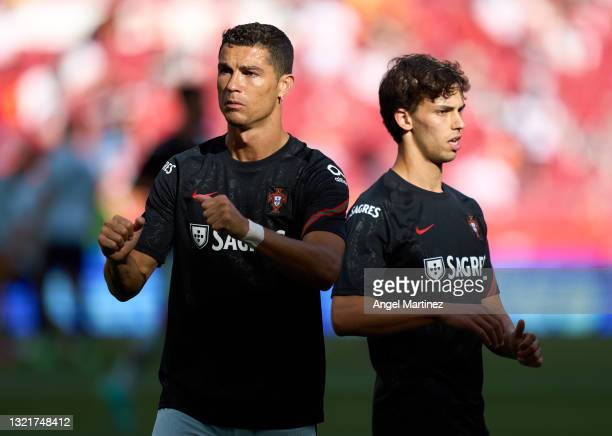 Cristiano Ronaldo and Joao Felix of Portugal warm up prior to the international friendly match between Spain and Portugal at Estadio Wanda...
