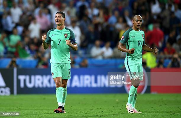 Cristiano Ronaldo and Joao Mario of Portugal celebrate victory after the UEFA EURO 2016 semi final match between Portugal and Wales at Stade des...