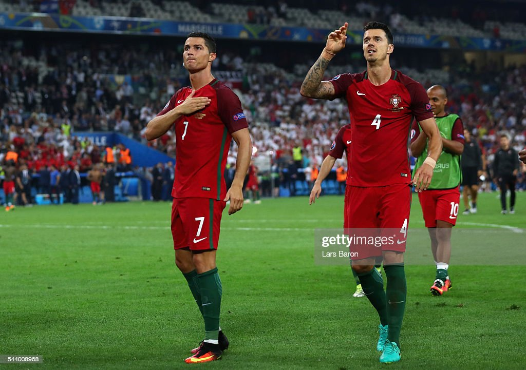 Cristiano Ronaldo (L) and Jose Fonte (R) of Portugal celebrate their team's win after the UEFA EURO 2016 quarter final match between Poland and Portugal at Stade Velodrome on June 30, 2016 in Marseille, France.