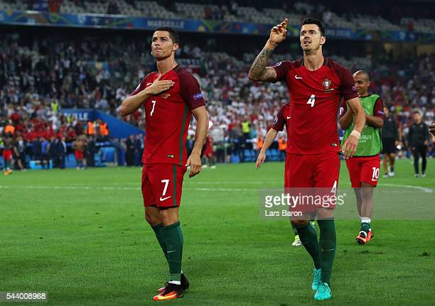 Cristiano Ronaldo and Jose Fonte of Portugal celebrate their team's win after the UEFA EURO 2016 quarter final match between Poland and Portugal at...