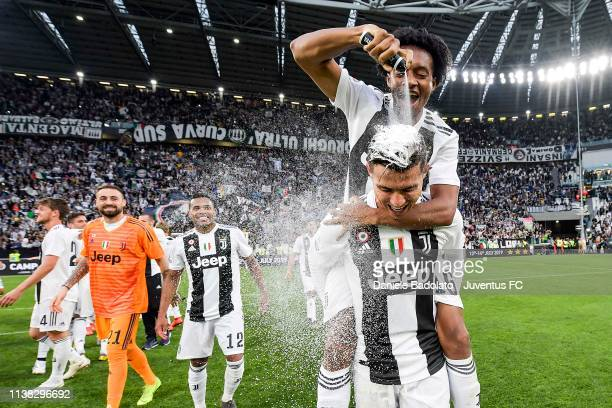 Cristiano Ronaldo and Juan Cuadrado of Juventus celebrate the winning of the Italian championship 2018-2019 after the Serie A match between Juventus...