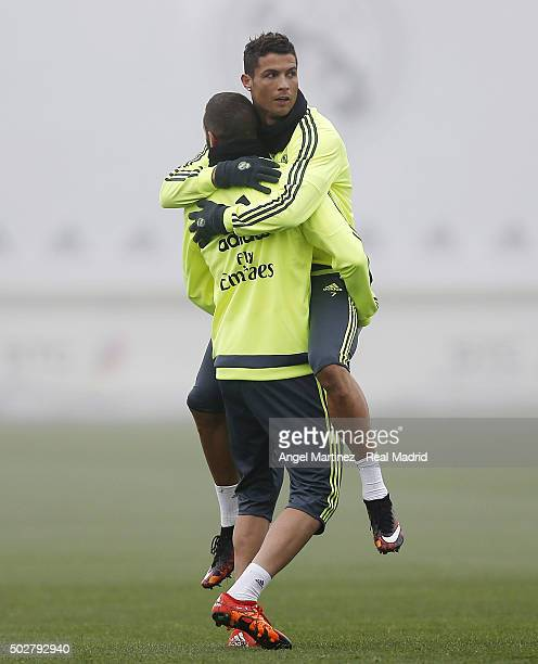Cristiano Ronaldo and Karim Benzema of Real Madrid celebrate during a training session at Valdebebas training ground on December 29 2015 in Madrid...