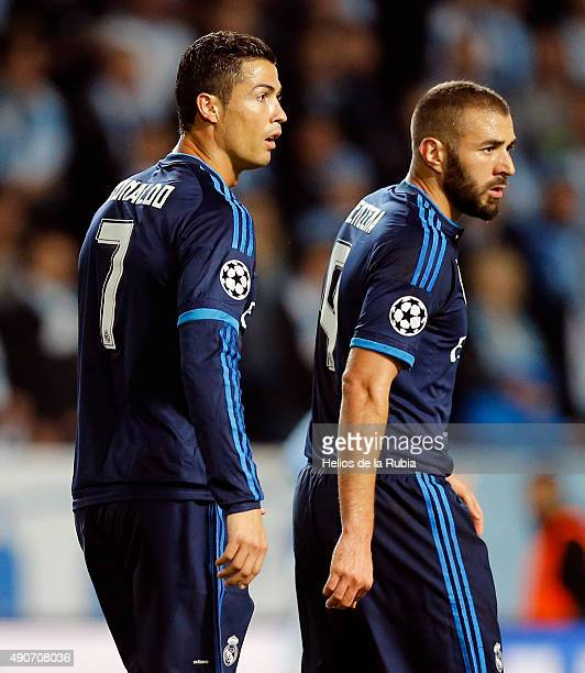 Cristiano Ronaldo and Karim Benzema of Real Madrid look on during the UEFA Champions League Group A match between Malmo fc and Real Madrid CF at...