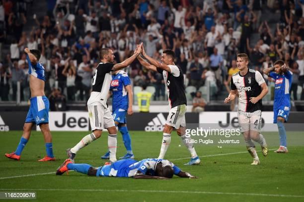 Cristiano Ronaldo and Leonardo Bonucci celebrate the own goal of Kalidou Koulibaly of SSC Napoli to make it 4-3 during the Serie A match between...