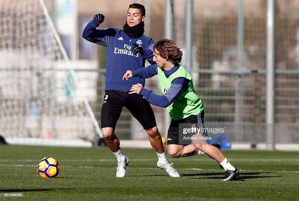 Cristiano Ronaldo (L) and Luka Modric of Real Madrid during a training session at Valdebebas training ground on January 6, 2017 in Madrid, Spain.