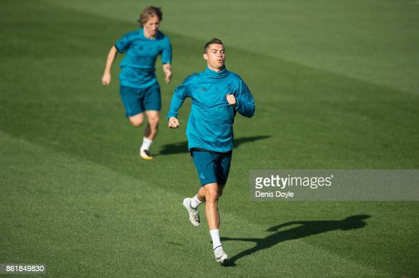 Cristiano Ronaldo and Luka Modric of Real Madrid warmup during the Real Madrid training session at Valdebebas training ground on October 16 2017 in...