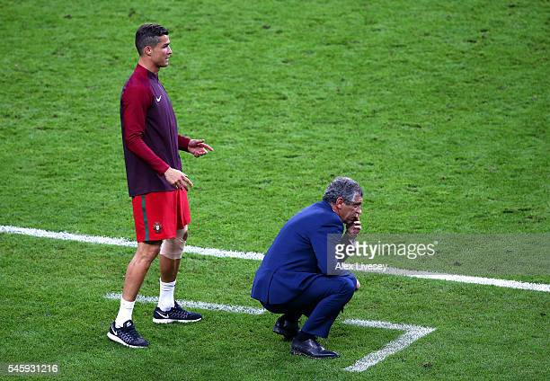 Cristiano Ronaldo and manager Fernando Santos look on during the UEFA EURO 2016 Final match between Portugal and France at Stade de France on July 10...