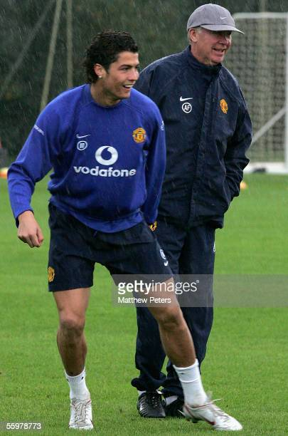 Cristiano Ronaldo and Manager Sir Alex Ferguson of Manchester United in action during a first team training session at Carrington Training Ground on...