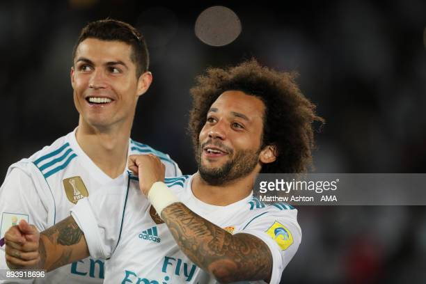 Cristiano Ronaldo and Marcelo of Real Madrid celebrate at the end of the FIFA Club World Cup UAE 2017 final match between Gremio and Real Madrid CF...