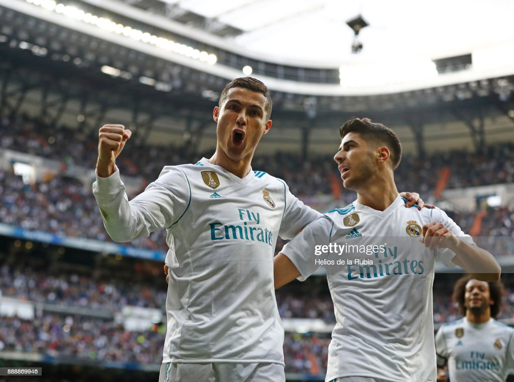 Cristiano Ronaldo and Marco Asensio of Real Madrid celebrate after scoring during the La Liga match between Real Madrid and Sevilla at Estadio Santiago Bernabeu on December 9, 2017 in Madrid, Spain.