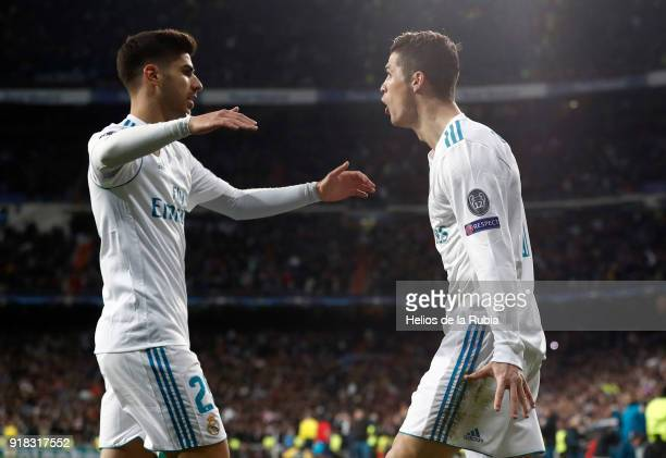 Cristiano Ronaldo and Marco Asensio of Real Madrid celebrate after scoring during the UEFA Champions League Round of 16 First Leg match between Real...