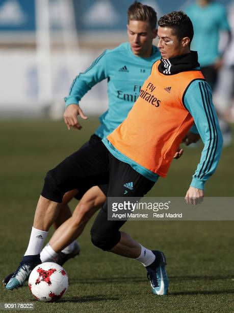 Cristiano Ronaldo and Marcos Llorente of Real Madrid in action during a training session at Valdebebas training ground on January 23 2018 in Madrid...