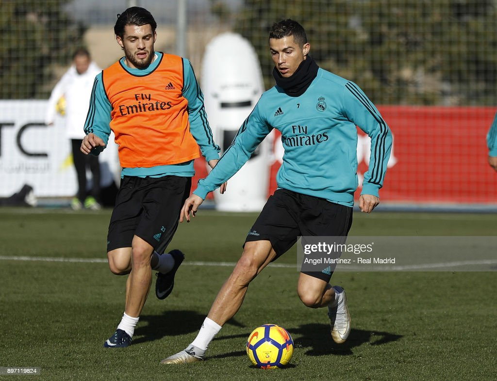Cristiano Ronaldo (R) and Mateo Kovacic of Real Madrid in action during a training session at Valdebebas training ground on December 22, 2017 in Madrid, Spain.