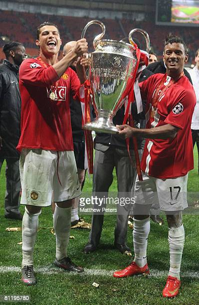 Cristiano Ronaldo and Nani of Manchester United celebrate with the trophy after winning the UEFA Champions League Final match between Manchester...