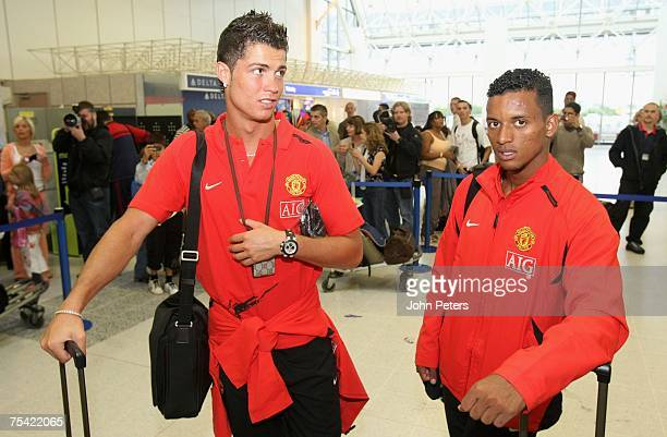 Cristiano Ronaldo and Nani of Manchester United check in ahead of Manchester United's preseason tour of Japan China and South Korea at Manchester...