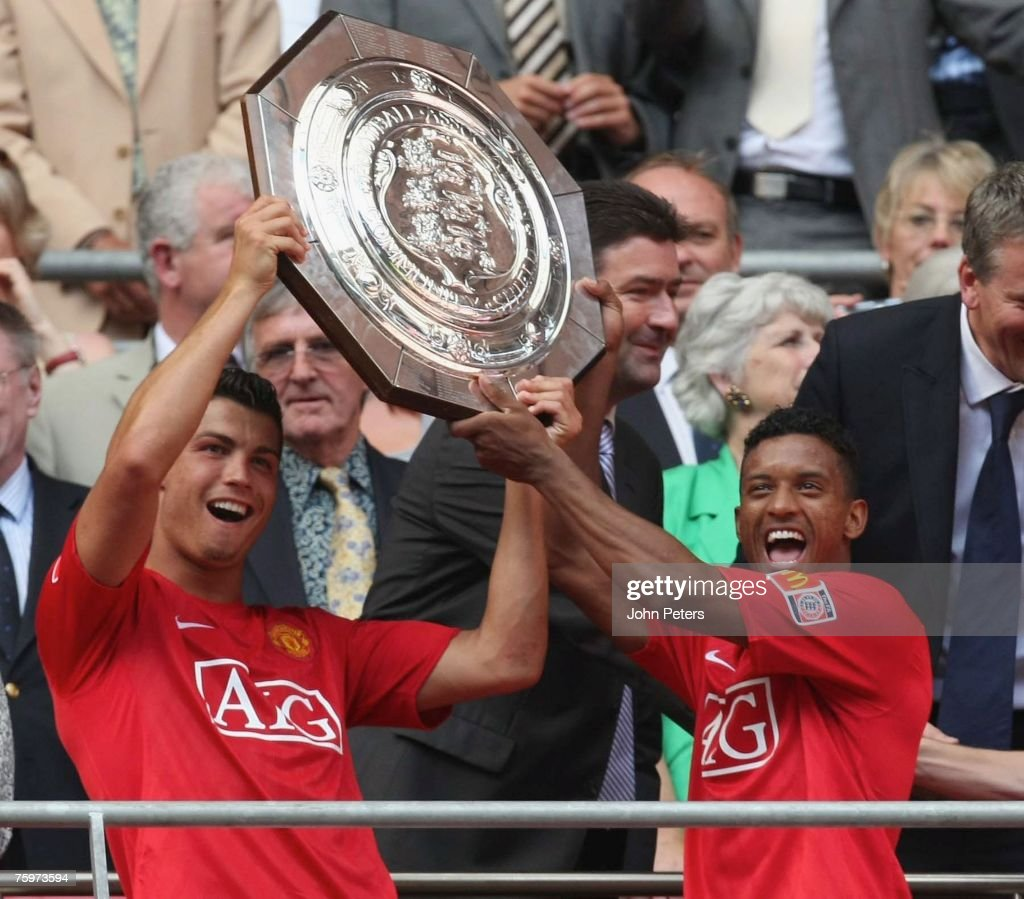Cristiano Ronaldo and Nani of Manchester United lift the Community Shield after winning the pre-season friendly match between Chelsea and Manchester United at Wembley Stadium on August 5 2007 in London, England.