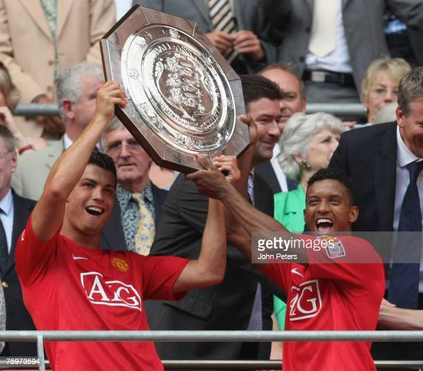 Cristiano Ronaldo and Nani of Manchester United lift the Community Shield after winning the preseason friendly match between Chelsea and Manchester...