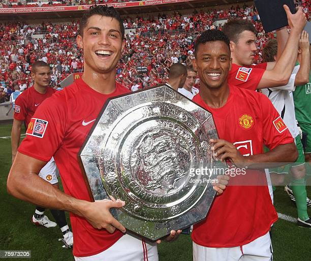 Cristiano Ronaldo and Nani of Manchester United poses with the Community Shield after winning the preseason friendly match between Chelsea and...