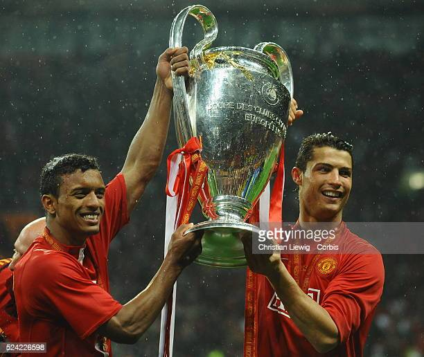 Cristiano Ronaldo and Nani with the Champions League trophy after the UEFA Champions League Final between Chelsea and Manchester United at the...