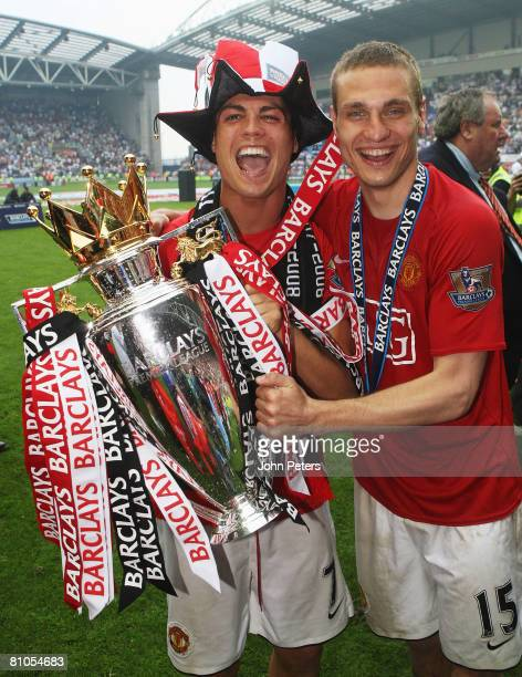 Cristiano Ronaldo and Nemanja Vidic of Manchester United celebrates with the Premier League trophy on the pitch after the Barclays FA Premier League...