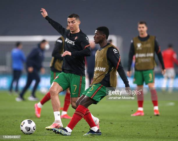 Cristiano Ronaldo and Nuno Mendes of Portugal warms up prior to the FIFA World Cup 2022 Qatar qualifying match between Portugal and Azerbaijan on...