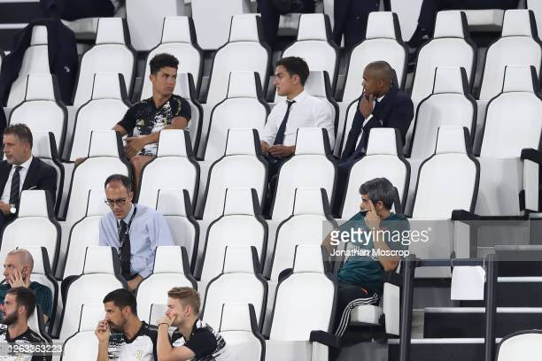 Cristiano Ronaldo and Paulo Dybala of Juventus discuss as teammate Douglas Costa looks on during the Serie A match between Juventus and AS Roma on...