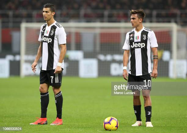 Cristiano Ronaldo and Paulo Dybala of Juventus FC look on during the Serie A match between AC Milan and Juventus at Stadio Giuseppe Meazza on...