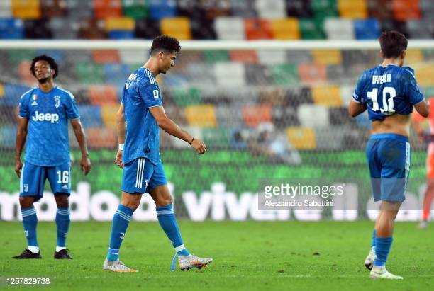 Cristiano Ronaldo and Paulo Dybala of Juventus reacts after the Serie A match between Udinese Calcio and Juventus at Stadio Friuli on July 23 2020 in...