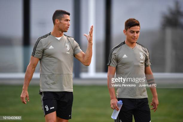 Cristiano Ronaldo and Paulo Dybala of Juventus talk during a training session at JTC on August 3 2018 in Turin Italy