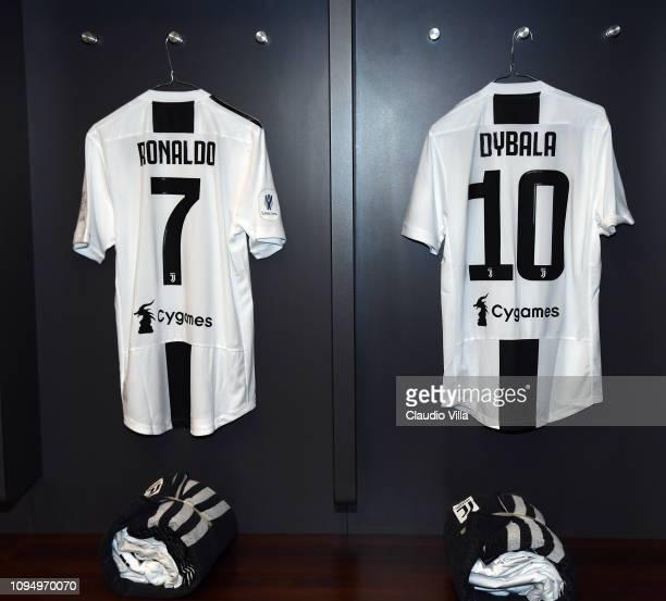 Cristiano Ronaldo and Paulo Dybala shirts hang inside the Juventus dressing room ahead of the Italian Supercup match between Juventus and AC Milan at...