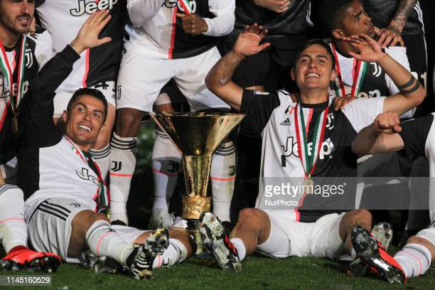 Cristiano Ronaldo and Paulo Dybala with the trophy of Scudetto during the victory ceremony following the Italian Serie A last football match of the...