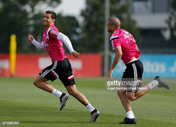 Cristiano Ronaldo and Pepe of Real Madrid run during a training session at Valdebebas training ground on April 25 2015 in Madrid Spain