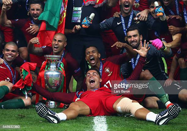 Cristiano Ronaldo and Portugal players celebrate after their 10 win against France in the UEFA EURO 2016 Final match between Portugal and France at...