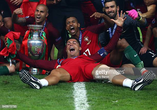 Cristiano Ronaldo and Portugal players celebrate after their 1-0 win against France in the UEFA EURO 2016 Final match between Portugal and France at...
