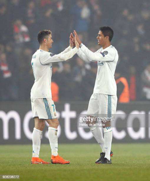 Cristiano Ronaldo and Raphael Varane of Real Madrid celebrate after scoring during the UEFA Champions League Round of 16 Second Leg match between...