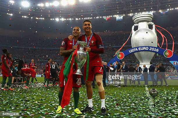 Cristiano Ronaldo and Ricardo Quaresma and Portugal hold the Henri Delaunay trophy to celebrate after their 10 win against France in the UEFA EURO...